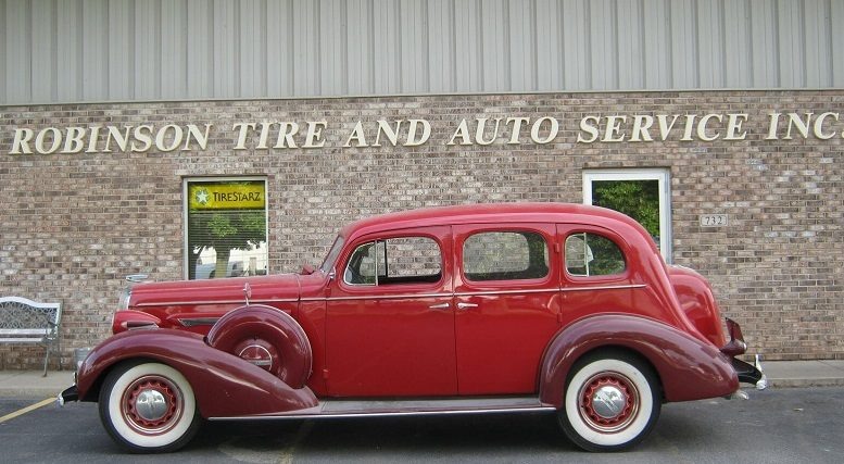 Best-One-of-Indy-acquires-Robinson-Tire-classic-car-in-front-of-building.jpg