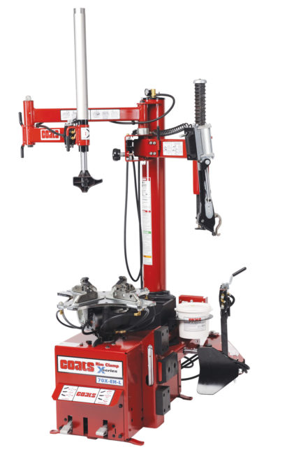 Coats tire changer features swing-arm lock