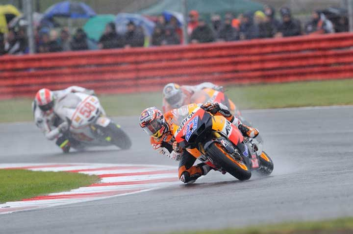 Stoner delivers wet-weather masterclass at soaked Silverstone