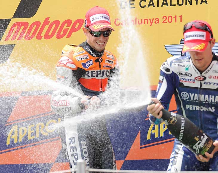 Stoner triumphs in tricky conditions at Catalunya