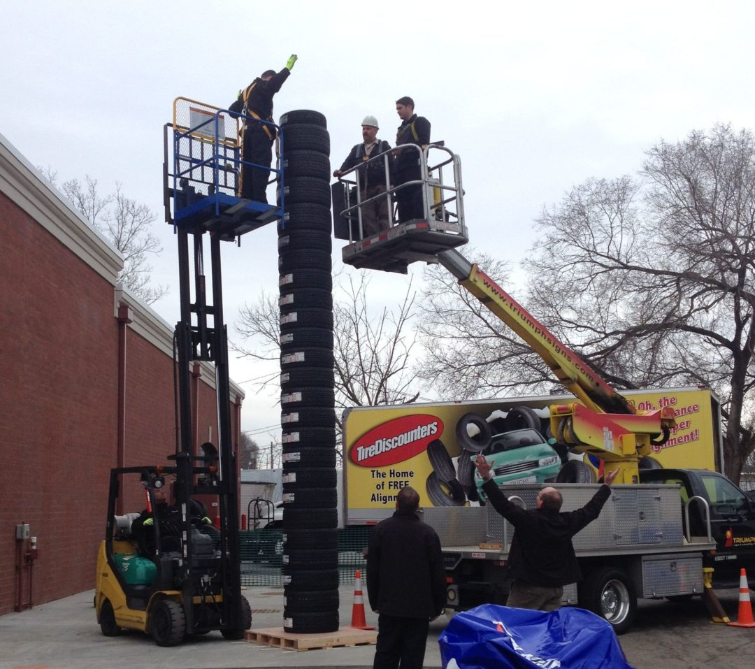 Tire Discounters stacks tires to celebrate history